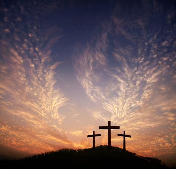 three crosses on a hill with feathered clouds