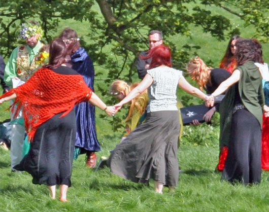 Photo of Wiccans performing a handfasting ceremony outdoors