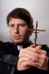 Catholic Priest Performing an Exorcism